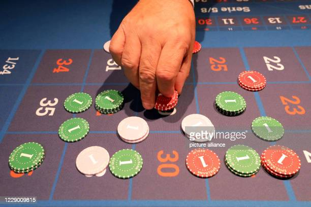 07 October 2020 MecklenburgWestern Pomerania Rostock Thomas Fritz Managing Director of Spielbanken MV GmbH Co KG bets the chips in Roulette For some...