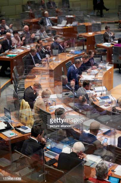 October 2020, North Rhine-Westphalia, Duesseldorf: Members of parliament, who are separated from each other by Plexiglas panels due to the corona...
