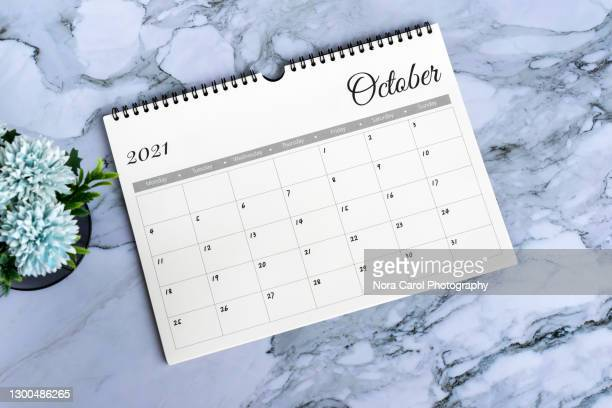 october 2021 calendar on marble desk - october stock pictures, royalty-free photos & images
