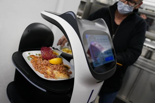 DEU: Restaurant Relies On Robots Due To Staff Shortage