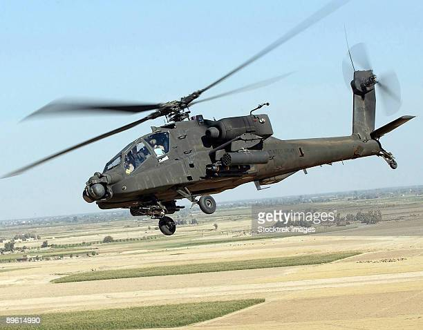 october 21, 2005 - a u.s. army ah-64d longbow apache provides ground forces with air support from forward operating base speicher iraq, during operation iraqi freedom.  t - apache helicopter stock pictures, royalty-free photos & images