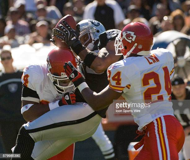 Kansas City Chiefs safety Jarrad Page with cornerback Ty Law jam Oakland Raiders wide receiver Ronald Curry on Sunday October 21 2007 at McAfee...