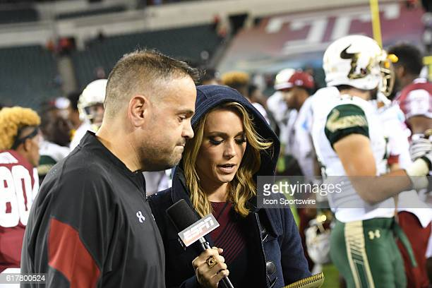 Temple Owls head coach Matt Rhule is interviewed by ESPN Molly Mcgrath during a NCAA Football game between the University of South Florida Bulls and...