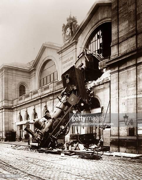 October 22, 1895 - Vintage photo of a locomotive derailment at Montparnasse Station, Paris, France.