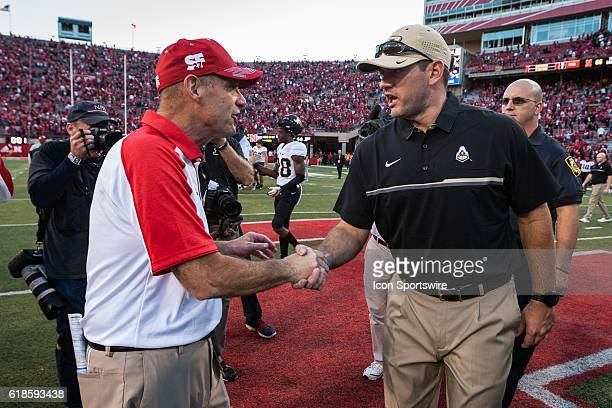 Head coach Mike Riley of the Nebraska Cornhuskers and interim head coach Gerad Parker of the Purdue Boilermakers shake hands after the game at...