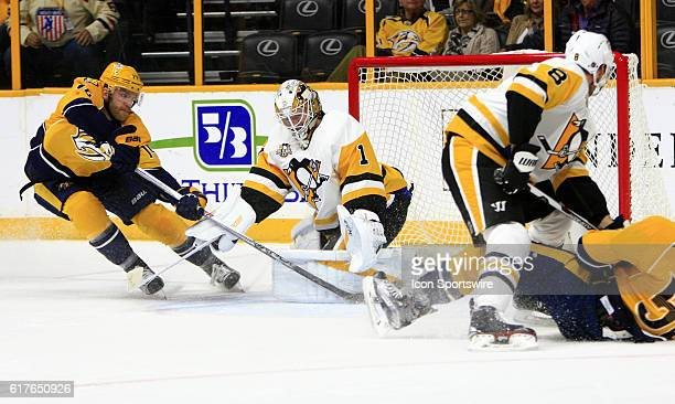 Nashville Predators defenseman Mattias Ekholm tries to score on Pittsburgh Penguins goalie Mike Condon during the NHL game between the Nashville...