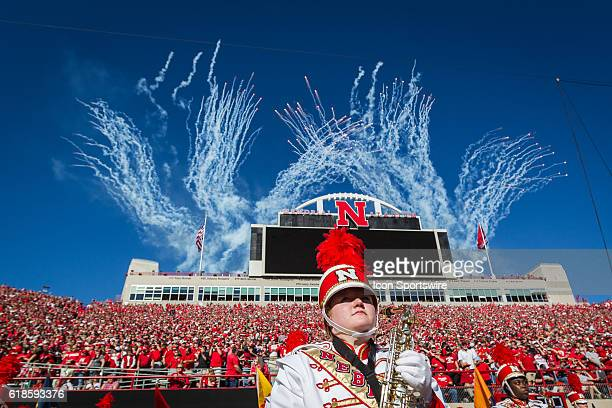 Nebraska Cornhuskers band member on the field before the game against Purdue as fireworks goes off from behind the score board at Memorial Stadium in...