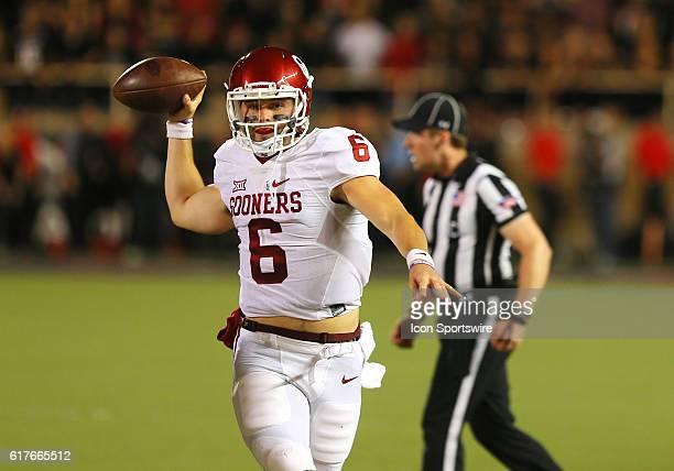 Oklahoma University quarterback Baker Mayfield throws on the run during the Texas Tech University Red Raider's 66-59 loss to the Oklahoma University...