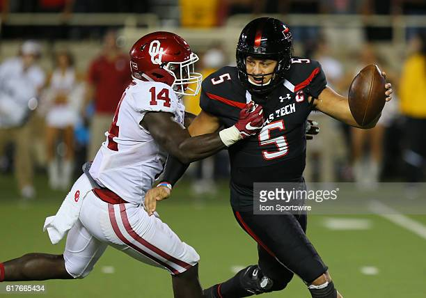 Texas Tech University quarterback Patrick Mahomes II is pressured by Oklahoma University line backer Emmanuel Beal during the Texas Tech University...