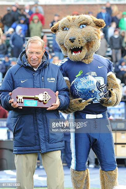 Villanova Wildcats mascot Wild E Cat and Villanova Wildcats head coach Andy Talley show off his Key to the field house that bears his name during a...