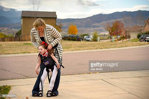 October 22, - A walking machine helps Haleigh walk with her mom, Janéa Cox. The equipment helps Haleigh stretch and use muscles the are mostly...