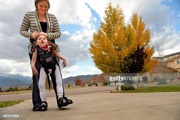 October 22, - Janéa Cox uses special equipment that lets her walk with her daughter. Haleigh is 5 years old and has never taken a normal step with...