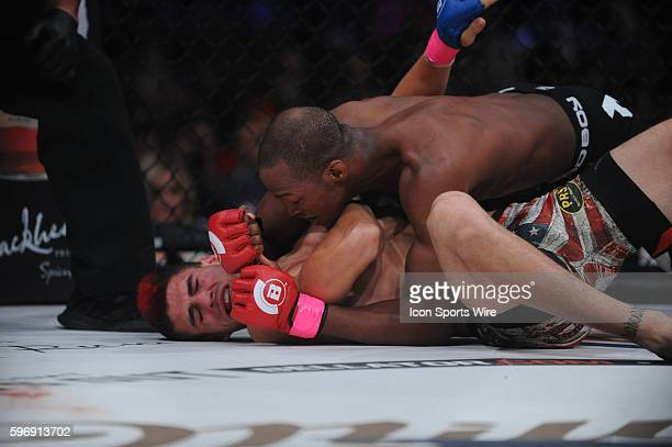 Michael Page lands a punch to Charlie Ontiveros as they battle at the Mohegan Sun Arena in Uncasville Connecticut Michael Page defeats Charlie...