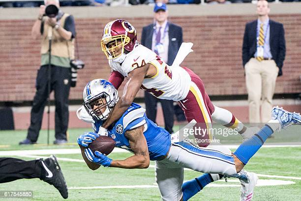 Detroit Lions wide receiver Marvin Jones reaches out to catch this long pass with Washington Redskins cornerback Josh Norman draped over his back...