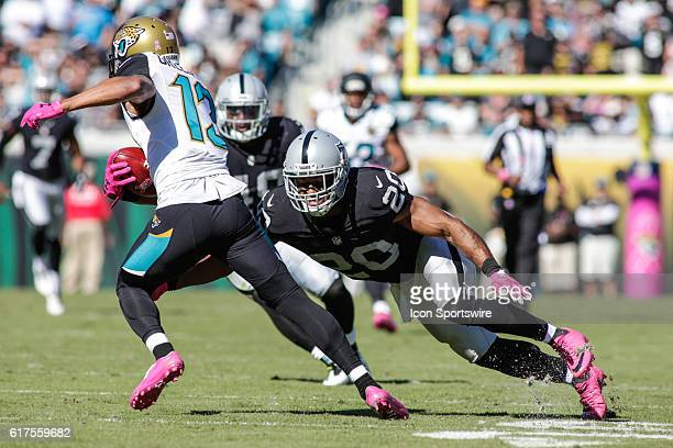 Oakland Raiders Safety Nate Allen attempts to tackle Jacksonville Jaguars Wide Receiver Rashad Greene during the NFL game between the Oakland Raiders...