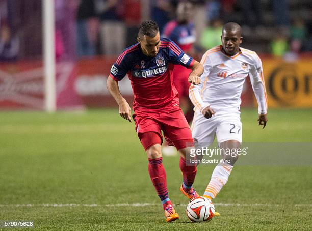 Chicago Fire midfielder Alex tackles the ball away from Houston Dynamo's Oscar Garcia in the match between the Chicago Fire and Houston Dynamo hosted...