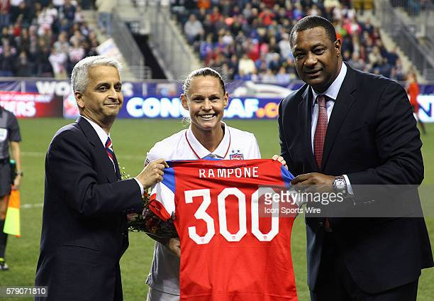 Christine Rampone of the USA is presented with a shirt commemorating her three hundredth game for the USA by Sunil Gulati head of USA soccer and...