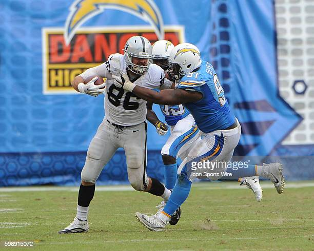 October 25 2015 San Diego Chargers Defensive End Kendall Reyes [17645] takes down Oakland Raiders Tight End Lee Smith [17100] during the NFL football...