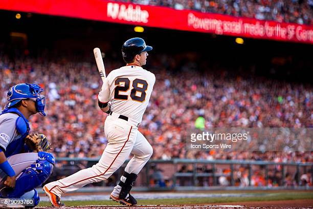 San Francisco Giants catcher Buster Posey at bat and following the trajectory of the ball in the first inning during game 5 of the World Series...