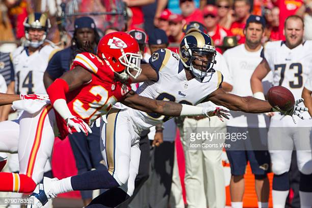 St Louis Rams wide receiver Brian Quick and Kansas City Chiefs strong safety Ron Parker reach for a pass during the NFL game between the St Louis...