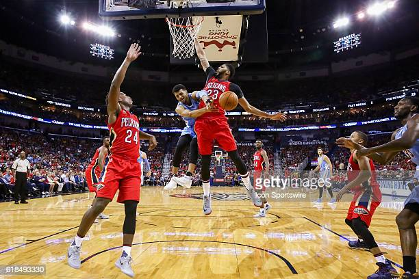 Denver Nuggets guard Jamal Murray passes the ball around New Orleans Pelicans forward Anthony Davis during the game between Denver Nuggets and New...