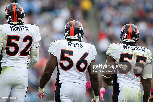 Denver Broncos linebackers Jason Hunter , Robert Ayers , and D. J. Williams during second half action. The Tennessee Titans were defeated by the...