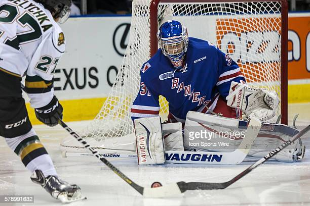 October 3, 2014. Kitchener Rangers goalie Matthew Greenfield prepares for a shot from London Knights forward Brett Welcyhka during a game between the...
