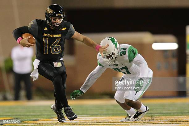 Southern Miss Golden Eagles quarterback Tyler Matthews fends off North Texas Mean Green linebacker Brandon Garner during the Southern Miss Golden...