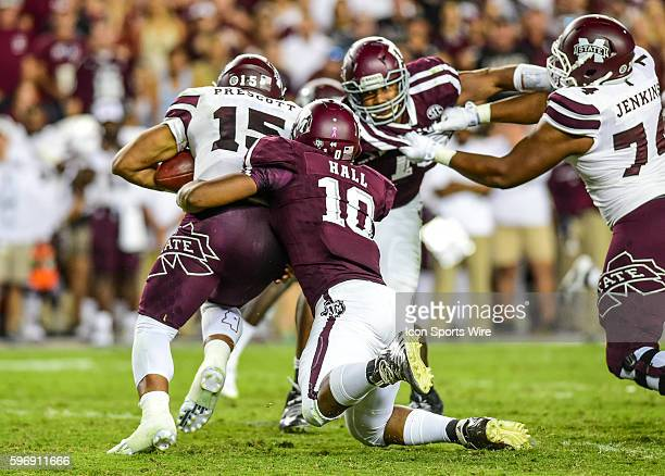 Texas AM Aggies defensive lineman Daeshon Hall drags Mississippi State Bulldogs quarterback Dra Prescott down from behind for a loss as Texas AM...