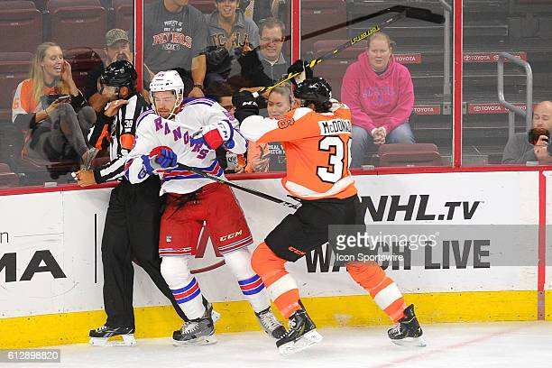New York Rangers defenseman Chris Summers is checked by Philadelphia Flyers right wing Colin McDonald during a Preseason National Hockey League game...