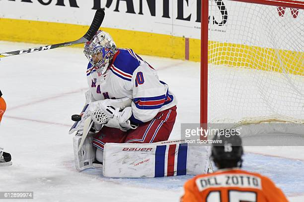 New York Rangers goalie Mackenzie Skapski makes a save during a Preseason National Hockey League game between the New York Rangers and the...