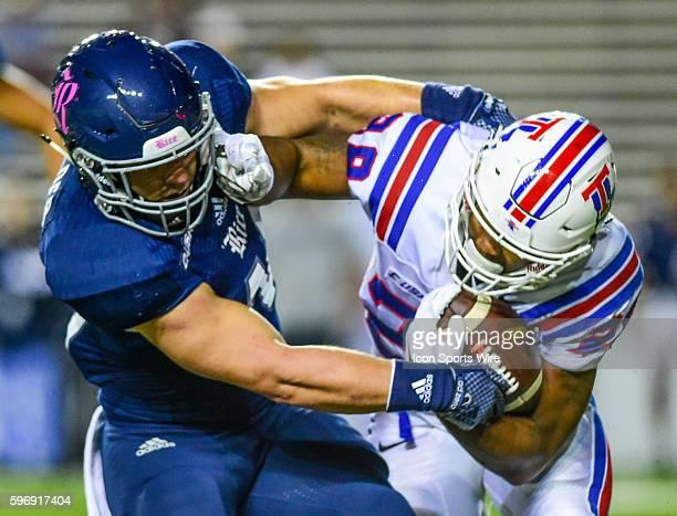 Louisiana Tech Bulldogs running back Kenneth Dixon stiff arms a defender during the Louisiana Tech Bulldogs vs the Rice Owls at Rice Stadium Houston...