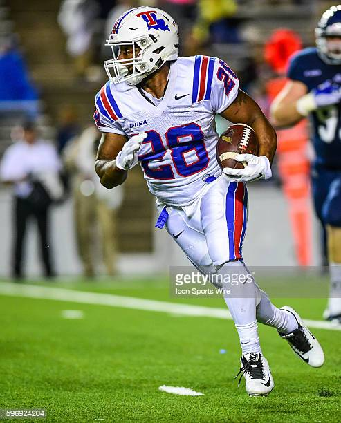 Louisiana Tech Bulldogs running back Kenneth Dixon breaks into the open field during the Louisiana Tech Bulldogs vs the Rice Owls at Rice Stadium...