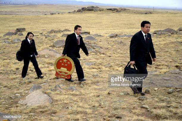 BEIJING October 30 2018 Ren Xiuyong 1st R a judge of the assize court in Urad Middle Banner pasture walks with colleagues to offer legal aids for...