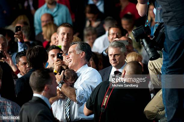 October 31 2012 GOVERNOR ROMNEY HOLDING BABY Governor Mitt Romney Campaigns In South Florida Governor Romney attends Coral Gables Victory Rally with...