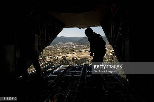 October 31, 2012 - U.S. Air Force Airman finishes pushing out pallets from a U.S. Air Force C-130H Hercules over Afghanistan.