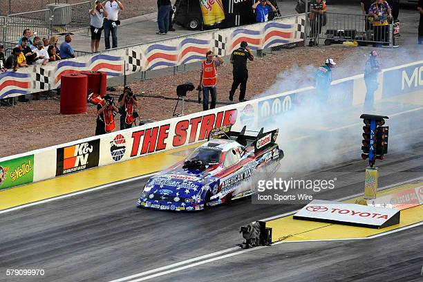 John Force Ford Mustang NHRA Funny Car does a burnout in the second round of qualifying for the 14th Annual Toyota Nationals on The Strip at Las...