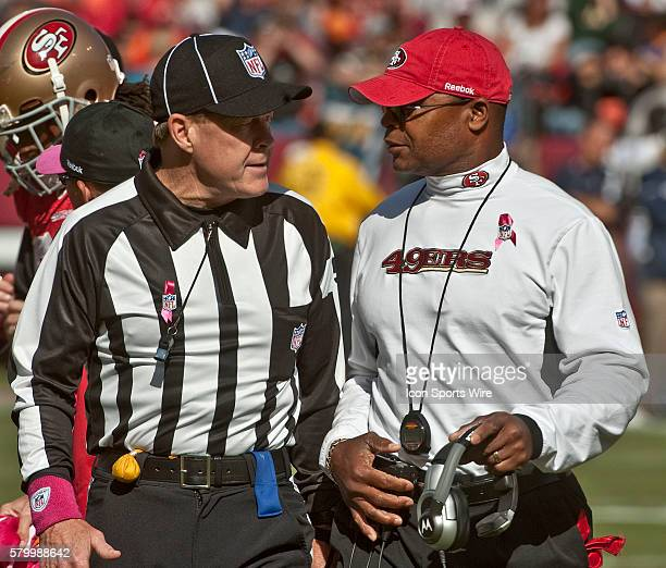 Head linesman John McGrath gives explanation on call to 49er head coach Mike Singletary on Sunday October 4 2009 at Candlestick Park in San Francisco...