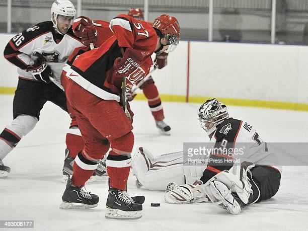 October 4 2012 Portland Pirates vs University of New Brunswick exhibition hockey game Pirate goalie Mark Visentin blocks a shot from UNB's Chris...