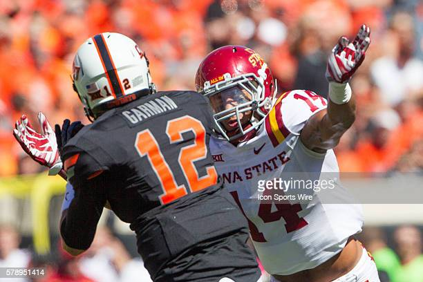 Iowa State Cyclones linebacker Jared Brackens closes his eyes tight as he's about to sack Oklahoma State Cowboys quarterback Daxx Garman during the...