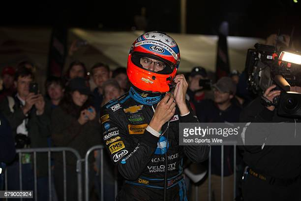 Jordan Taylor driver of the the racewinning Wayne Taylor Racing team's KonicaMinolta Chevrolet Corvette in the Prototype class driven by Ricky Taylor...