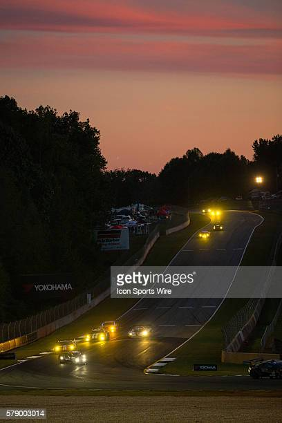 Race action at dusk during the Petit Le Mans Powered by Mazda, the season-ending IMSA race in the TUDOR United SportsCar Challenge series held at...