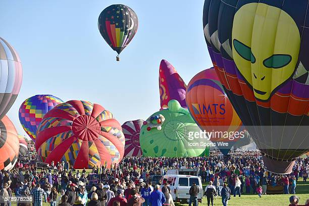 Thousands of people watch the launch of hundreds of balloons during the Mass Ascencion at the opening of the International Balloon Fiesta at Balloon...
