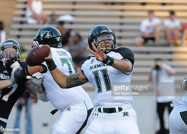 Hawaii Warriors quarterback Ikaika Woolsey throws a pass during the NCAA football match Rice vs Hawaii at Rice Stadium in Houston Tx