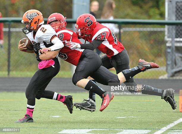 October 5 2013ë¦Scarborough vs Biddeford football game played at Scarborough Biddeford's Corey Creeger drags a pair of Scarborough defends as he...