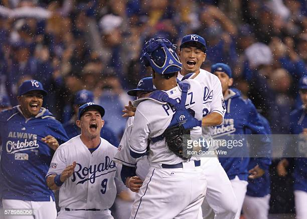 Kansas City Royals right fielder Nori Aoki celebrates with catcher Salvador Perez after the Kansas City Royals defeated the Los Angeles Angels 83 and...