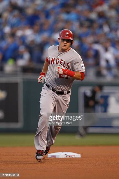 Los Angeles Angels center fielder Mike Trout rounds second base after hitting a solo home run in the 1st inning of Game 3 of the American League...