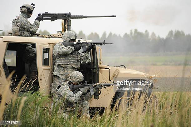 october 6, 2010 - u.s. soldiers perform a platoon mounted and dismounted live-fire exercise at grafenwoehr training area in germany. - infantry stock pictures, royalty-free photos & images