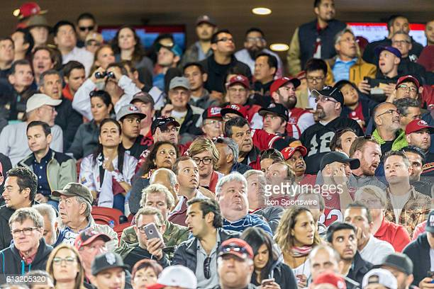Season ticket holders looking glum during the regular season NFL game between the Arizona Cardinals and the San Francisco 49ers at Levi's Stadium in...