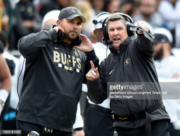 October 6 2018 University of Colorado's CoOffensive Coordinator Klayton Adams left and Colorado head coach Mike MacIntyre talks during the game with...